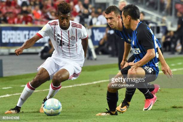 Bayern Munich's Kingsley Coman fights for the ball with Inter Milan's Ivan Perisic and Yuto Nagatomo during their International Champions Cup...