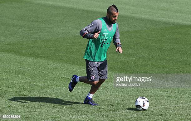Bayern Munich's midfielder Arturo Vidal takes part in a training session at the Aspire Academy in Doha on January 4 2017 / AFP / KARIM JAAFAR