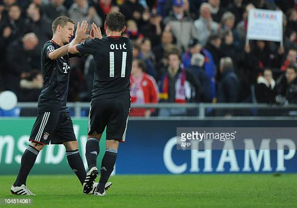 Bayern Munich's midfielder Bastian Schweinsteiger and his teammate Croatian striker Ivica Olic react during their second football UEFA Champions...
