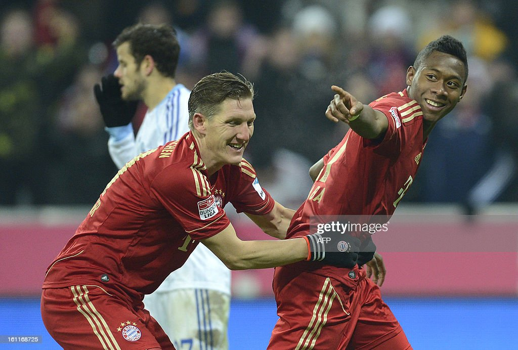 Bayern Munich's midfielder Bastian Schweinsteiger (L) and his teammate Bayern Munich's Austrian midfielder David Alaba celebrate after the third goal for Munich during the German first division Bundesliga football match FC Bayern Munich vs Fc Schalke 04 in Munich, southern Germany, on February 9, 2013.