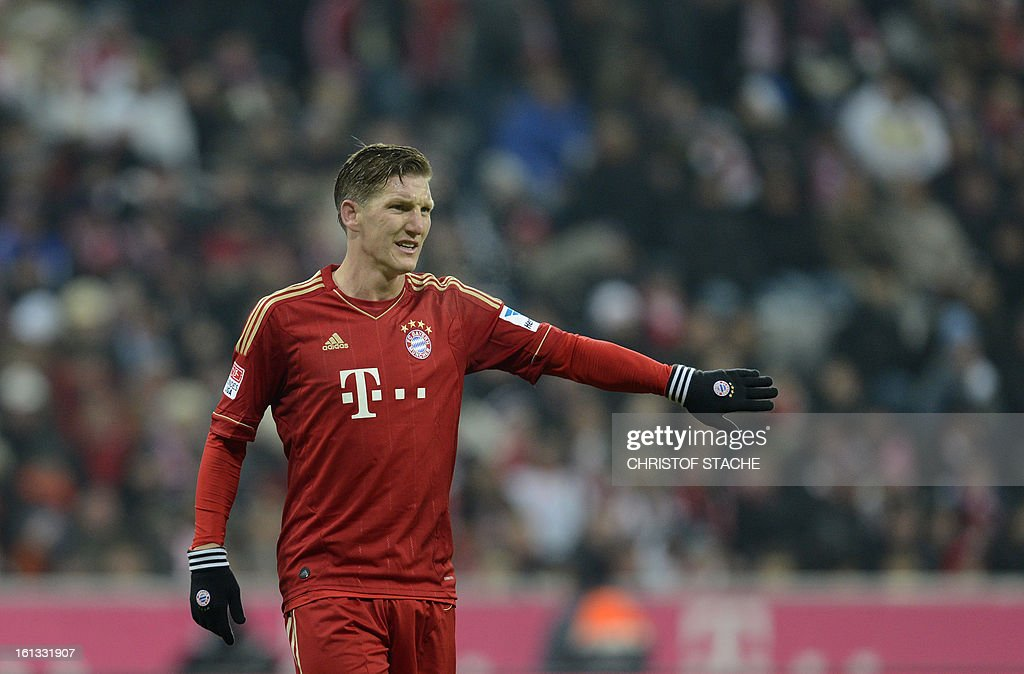 Bayern Munich's midfielder Bastian Schweinsteiger gestures during the German first division Bundesliga football match FC Bayern Munich vs Fc Schalke 04 in Munich, southern Germany, on February 9, 2013.