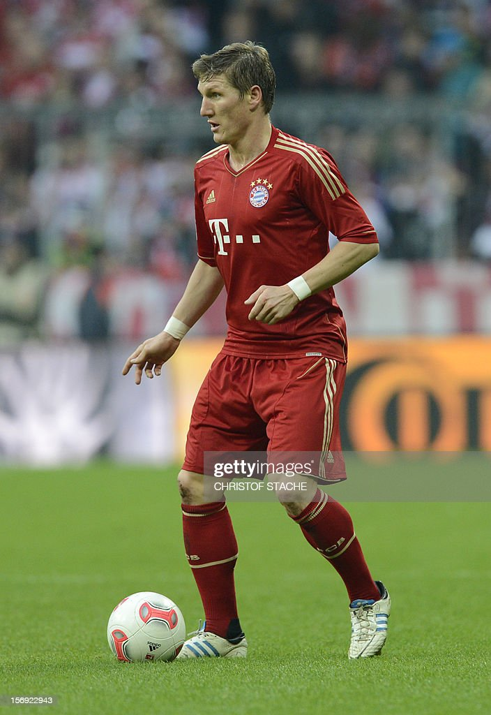 Bayern Munich's midfielder Bastian Schweinsteiger plays the ball during the German first division Bundesliga football match FC Bayern Munich vs Hanover 96 in Munich, southern Germany, on November 24, 2012. Bayern Munich won the match 5-0. AFP PHOTO / CHRISTOF STACHE