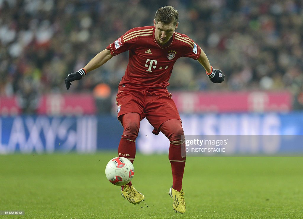Bayern Munich's midfielder Bastian Schweinsteiger plays the ball during the German first division Bundesliga football match FC Bayern Munich vs Fc Schalke 04 in Munich, southern Germany, on February 9, 2013.