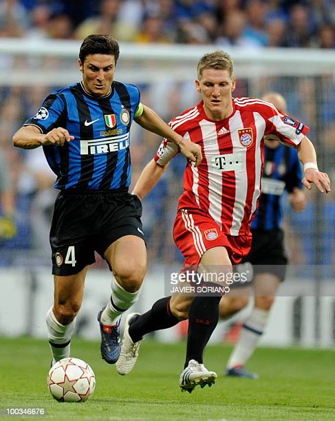 Bayern Munich's midfielder Bastian Schweinsteiger runs with Inter Milan's Argentinian defender and captain Javier Aldemar Zanetti during the UEFA...