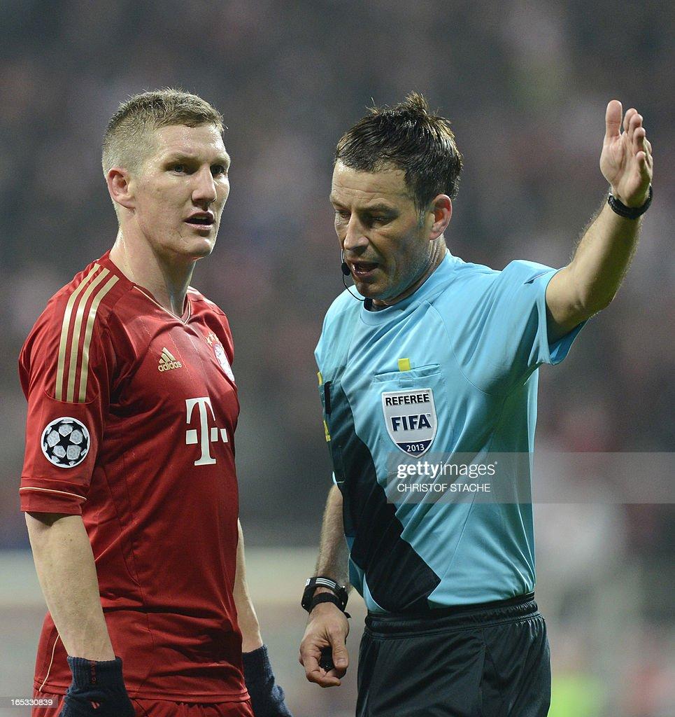 Bayern Munich's midfielder Bastian Schweinsteiger (L) speaks with English referee Mark Clattenburg during the UEFA Champions League quarter final football match FC Bayern Munich vs Juventus Turin in Munich, southern Germany, on April 2, 2013.