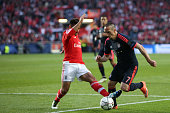Bayern Munich's midfielder Franck Ribry vies with Benfica's midfielder Eduardo Salvio during the UEFA Champions League quarterfinal second leg...