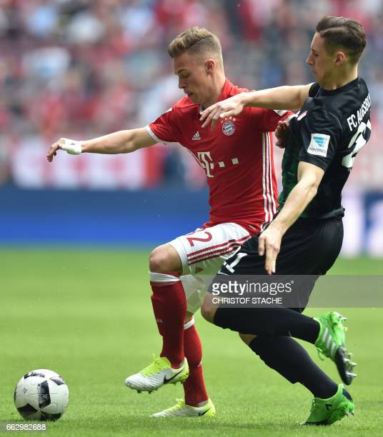 Bayern Munich's midfielder Joshua Kimmich and Augsburg's midfielder Dominik Kohr vie for the ball during the German first division Bundesliga...