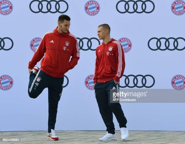 Bayern Munich's midfielder Joshua Kimmich and Bayern Munich's defender Niklas Suele talk during a car handover event at the Audi headquarters in...