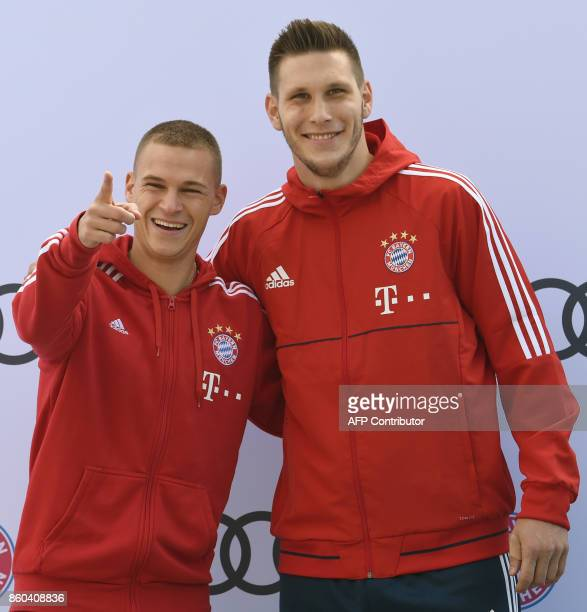 Bayern Munich's midfielder Joshua Kimmich and Bayern Munich's defender Niklas Suele pose during a car handover event at the Audi headquarters in...