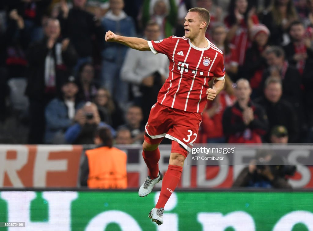 Bayern Munich's midfielder Joshua Kimmich celebrates scoring the second goal during the Champions League group B match between FC Bayern Munich and Celtic Glasgow in Munich, southern Germany, on October 18, 2017. / AFP PHOTO / Christof STACHE
