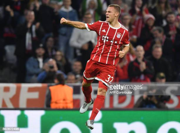 Bayern Munich's midfielder Joshua Kimmich celebrates scoring the second goal during the Champions League group B match between FC Bayern Munich and...