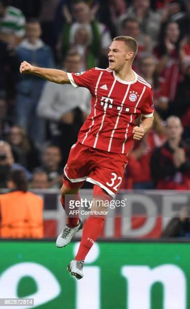 Bayern Munich's midfielder Joshua Kimmich celebrates scoring the second goal during the Champions League group B match between FC Bayern Munich and...
