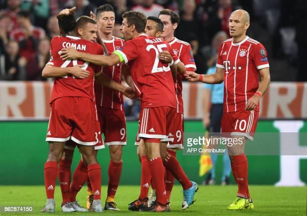 Bayern Munich's midfielder Joshua Kimmich celebrates scoring with his teammates during the Champions League group B match between FC Bayern Munich...