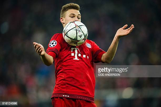 Bayern Munich's midfielder Joshua Kimmich controls the the ball during the UEFA Champions League Round of 16 second leg football match FC Bayern...