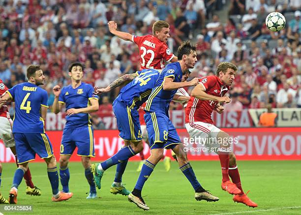 Bayern Munich's midfielder Joshua Kimmich heads in the 40 goal during the Champions League group D football match between Bayern Munich and Rostov in...