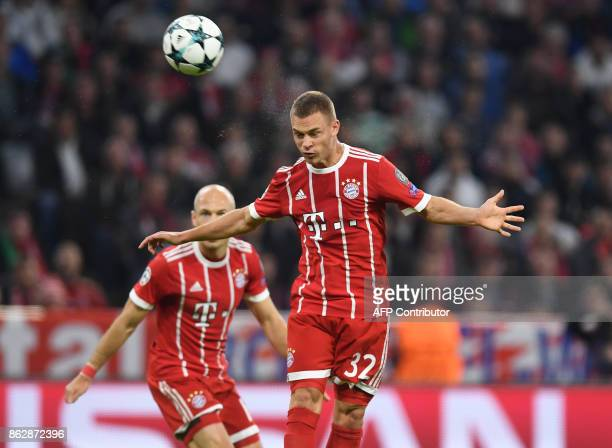 Bayern Munich's midfielder Joshua Kimmich heads the second goal during the Champions League group B match between FC Bayern Munich and Celtic Glasgow...