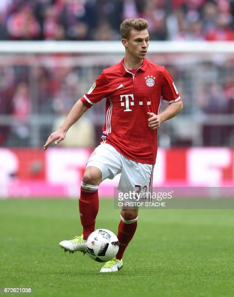Bayern Munich's midfielder Joshua Kimmich plays the ball during the German first division Bundesliga football match between FC Bayern Munich and...