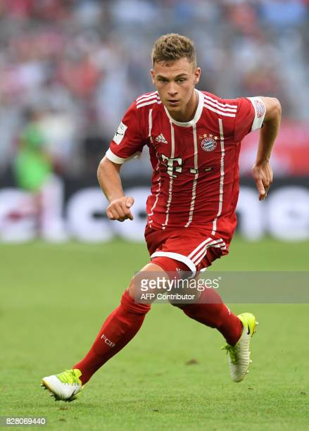 Bayern Munich's midfielder Joshua Kimmich runs during the third place Audi Cup football match between SSC Napoli and Bayern Munich in the stadium in...