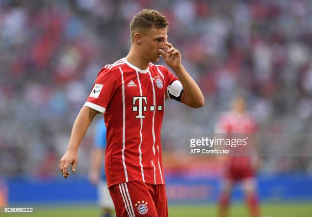 Bayern Munich's midfielder Joshua Kimmich wipes his face during the third place Audi Cup football match between SSC Napoli and Bayern Munich in the...