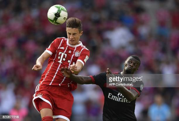 Bayern Munich's midfielder Marco Friedl and AC Milan's M'baye Niang vie for the ball during the International Champions Cup football match between...