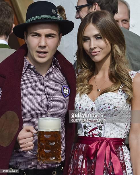 Bayern Munich's midfielder Mario Goetze and his girlfriend AnnKathrin Broemmel wear traditional Bavarian dresses as they attend German first division...