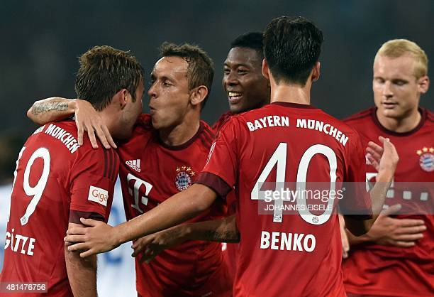 Bayern Munich's midfielder Mario Goetze celebrates a goal with teammates during a friendly football match between Bayern Munich and Inter Milan in...