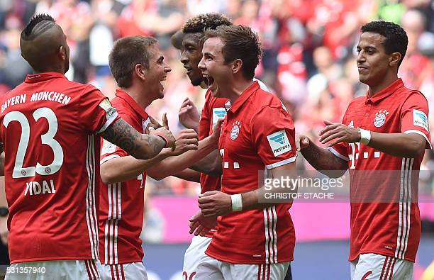 TOPSHOT Bayern Munich's midfielder Mario Goetze celebrates scoring his sides third goal with team mates during the German first division Bundesliga...