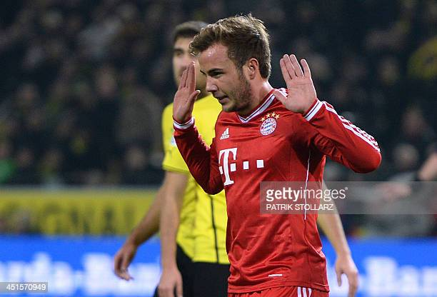 Bayern Munich's midfielder Mario Goetze gestures after scoring the 01 during the German first division Bundesliga football match between Borussia...