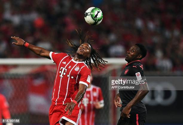 Bayern Munich's midfielder Renato Sanches and Arsenal forward Alex Iwobi vie for the ball during the International Champions Cup football match...