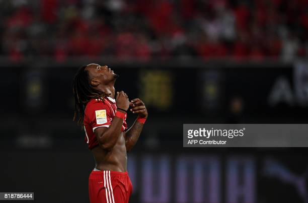 Bayern Munich's midfielder Renato Sanches reacts as he misses a goal during the penalty shootout during the International Champions Cup football...