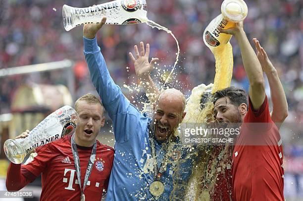 Bayern Munich's midfielder Sebastian Rode Bayern Munich's Spanish goalkeeper Jose Manuel Reina Bayern Munich's Spanish midfielder Xabi Alonso and...