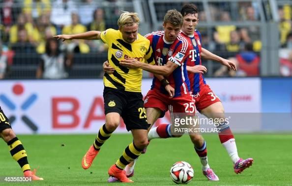 Bayern Munich's midfielder Thomas Mueller and Dortmund's defender Marcel Schmelzer vie during the German Supercup football match Borussia Dortmund vs...