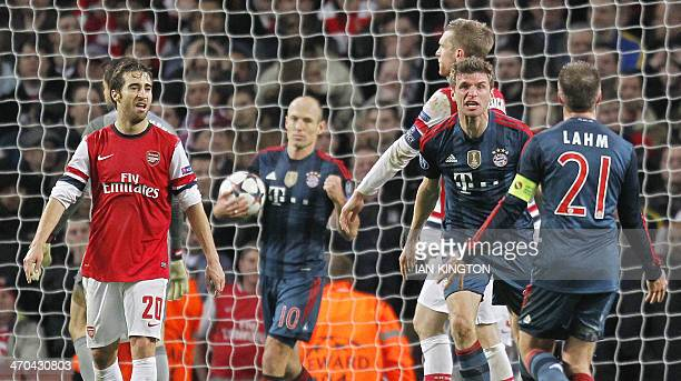 Bayern Munich's midfielder Thomas Mueller celebrates after scoring his team's second goal during the UEFA Champions League Last 16 first leg football...