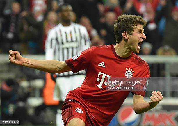 Bayern Munich's midfielder Thomas Mueller celebrates scoring the 22 goal during the UEFA Champions League Round of 16 second leg football match FC...