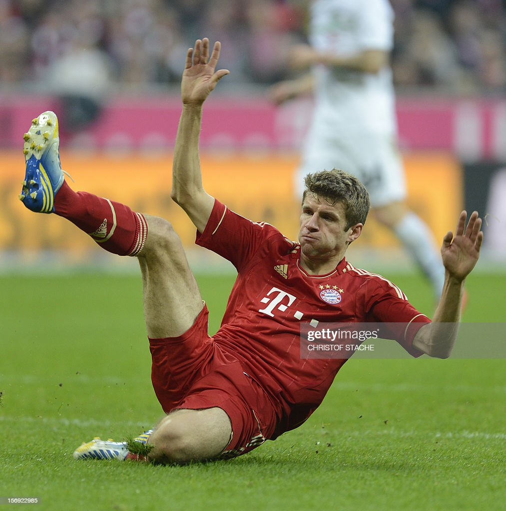 Bayern Munich's midfielder Thomas Mueller falls during the German first division Bundesliga football match FC Bayern Munich vs Hanover 96 in Munich, southern Germany, on November 24, 2012. Bayern Munich won the match 5-0. AFP PHOTO / CHRISTOF STACHE