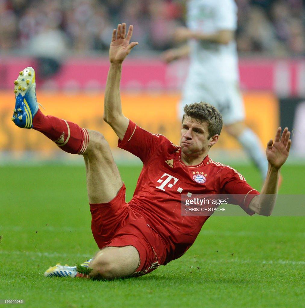 Bayern Munich's midfielder Thomas Mueller falls during the German first division Bundesliga football match FC Bayern Munich vs Hanover 96 in Munich, southern Germany, on November 24, 2012. Bayern Munich won the match 5-0.