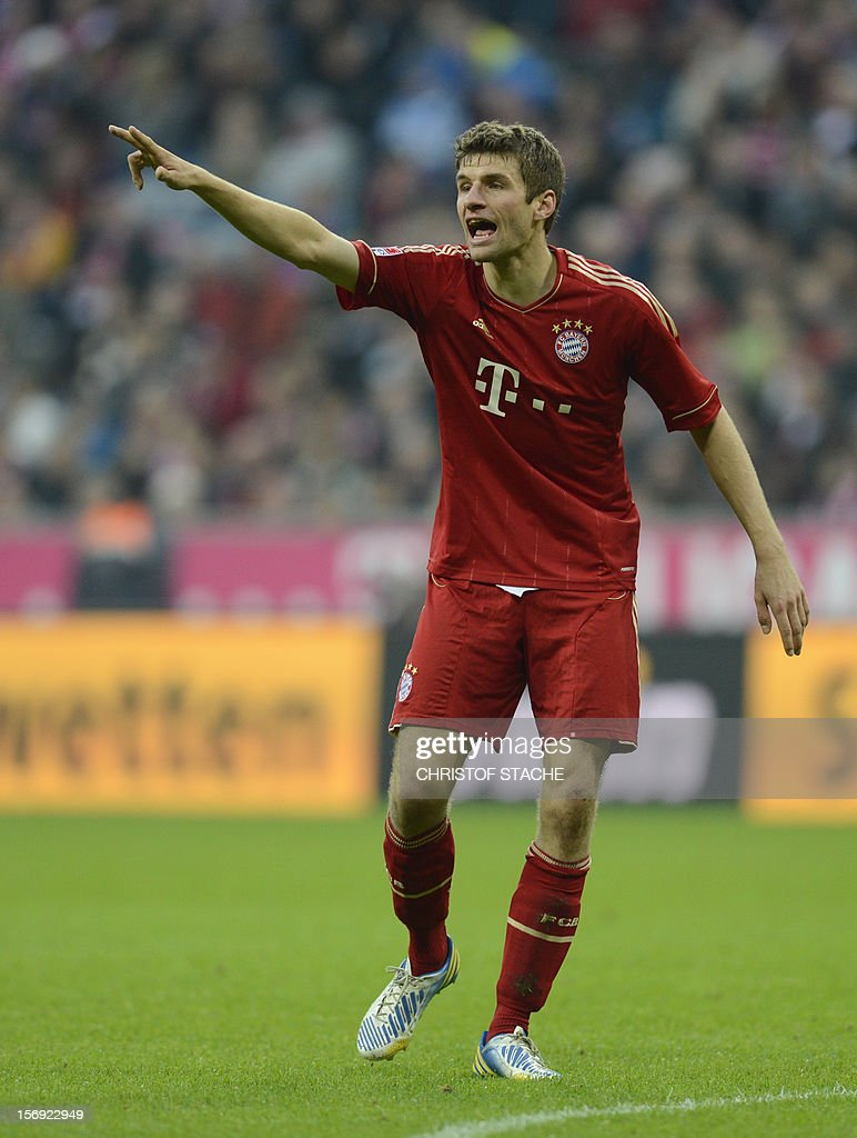 Bayern Munich's midfielder Thomas Mueller gestures during the German first division Bundesliga football match FC Bayern Munich vs Hanover 96 in Munich, southern Germany, on November 24, 2012. Bayern Munich won the match 5-0. AFP PHOTO / CHRISTOF STACHE