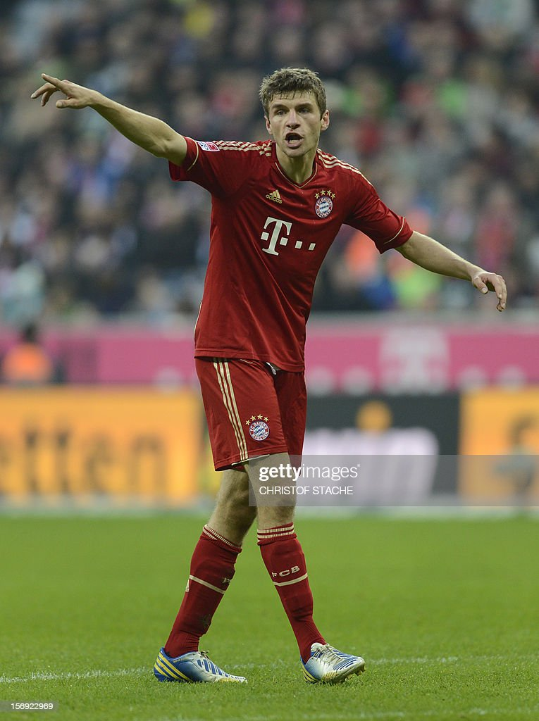 Bayern Munich's midfielder Thomas Mueller gestures during the German first division Bundesliga football match FC Bayern Munich vs Hanover 96 in Munich, southern Germany, on November 24, 2012. Bayern Munich won the match 5-0.