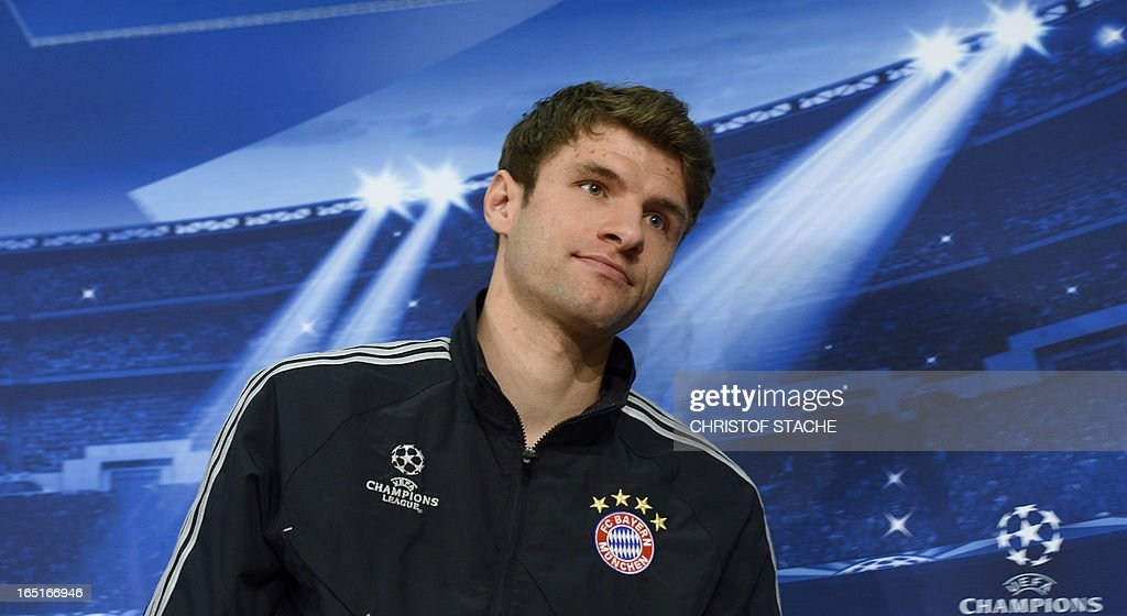 Bayern Munich's midfielder Thomas Mueller leaves after a press conference on the eve of the UEFA Champions League quarter final first-leg football match FC Bayern Munich vs Juventus Turin in Munich, southern Germany, on April 1, 2013.
