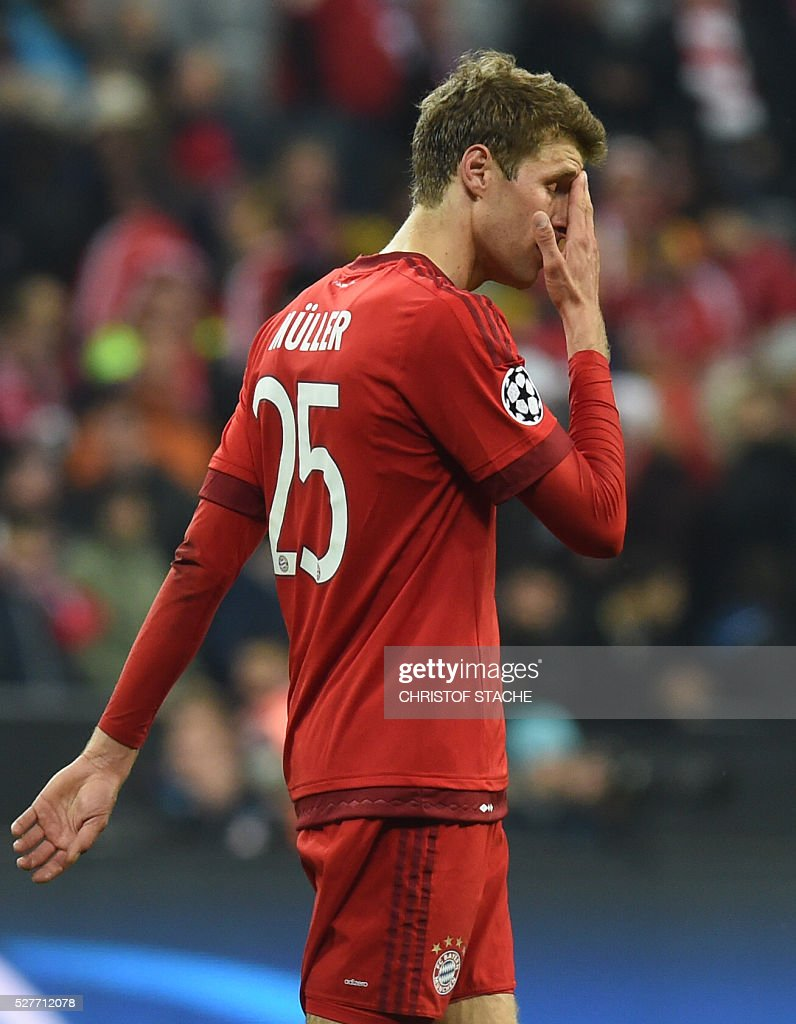 Bayern Munich's midfielder Thomas Mueller reacts while leaving the pitch after the UEFA Champions League semi-final, second-leg football match between FC Bayern Munich and Atletico Madrid in Munich, southern Germany, on May 3, 2016. / AFP / Christof Stache