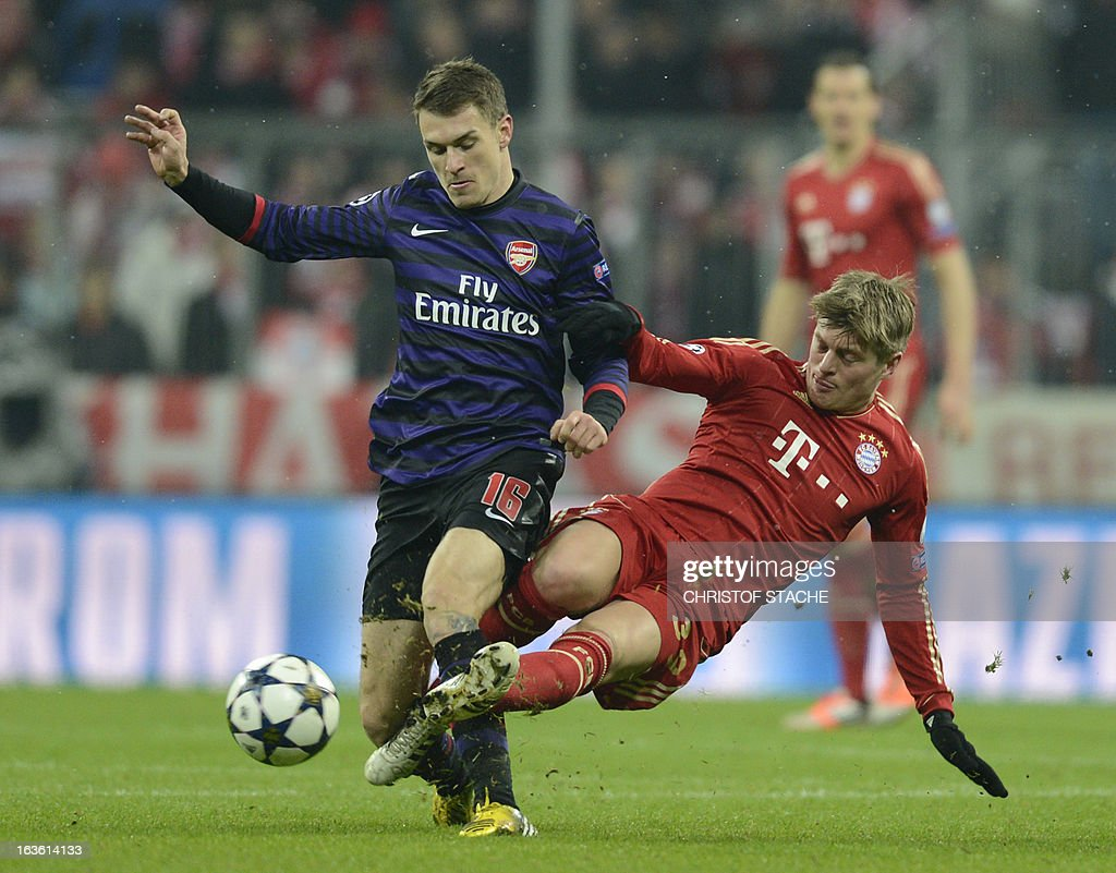 Bayern Munich's midfielder Toni Kroos (R) and Arsenal´s Welsh midfielder Aaron Ramsey vie for the ball during the UEFA Champions League Round of 16 second-leg football match FC Bayern Munich vs FC Arsenal London in Munich, southern Germany, on March 13, 2013.