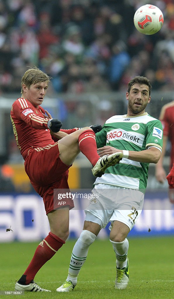 Bayern Munich's midfielder Toni Kroos (L) and Fuerth's midfielder Thanos Petsos (R) vie for the ball during the German first division Bundesliga football match FC Bayern Munich vs Greuther Fuerth in Munich, southern Germany, on January 19, 2013.