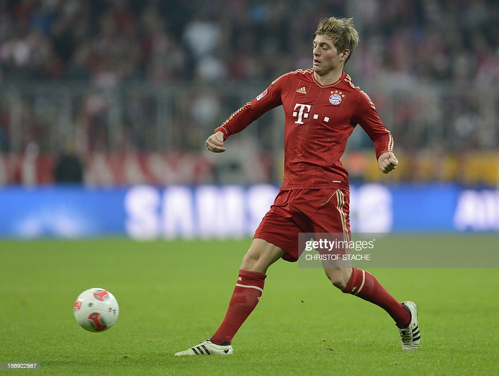 Bayern Munich's midfielder Toni Kroos plays the ball during the German first division Bundesliga football match FC Bayern Munich vs Hanover 96 in Munich, southern Germany, on November 24, 2012. Bayern Munich won the match 5-0. AFP PHOTO / CHRISTOF STACHE