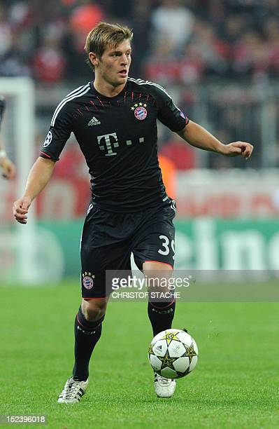 Bayern Munich's midfielder Toni Kroos runs with the ball during the UEFA Champions League group F football match FC Bayern Munich vs Valencia CF in...