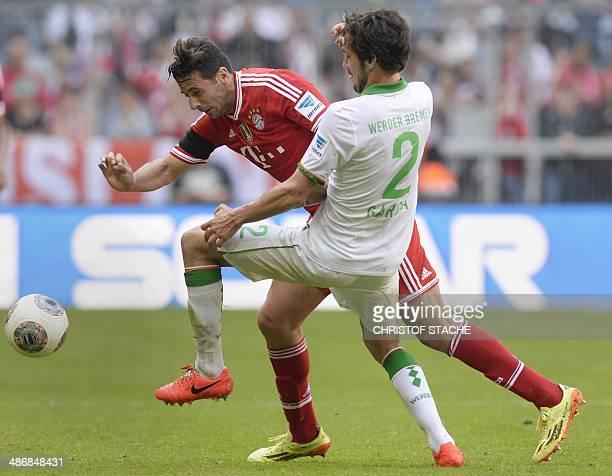 Bayern Munich's Peruvian striker Claudio Pizarro and Bremen's Argentinian defender Santiago Garcia vie for the ball during the German first division...