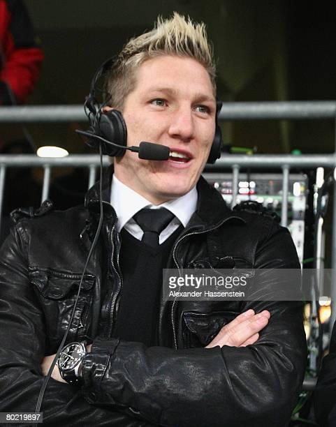 Bayern Munichs player Bastian Schweinsteiger seen as a TV commentator during the UEFA Cup Round of 16 second leg match between Bayern Munich and RSC...