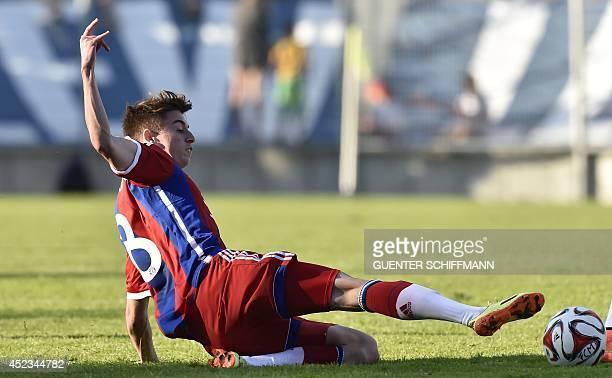 Bayern Munich's player Lucas Scholl son of former Bayern Munich player Mehmet Scholl vies for the ball during a friendly football match titled...