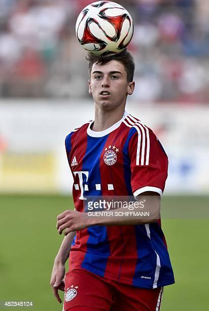 Bayern Munich's player Lucas Scholl son of former Bayern Munich's player Mehmet Scholl runs with the ball during a friendly football match titled...