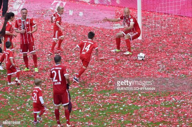 Bayern Munich's players and their children play football after the German first division Bundesliga football match FC Bayern Munich vs SC Freiburg...