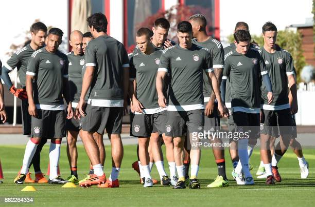Bayern Munich's players arrive for a training session on the eve of the Champions League group B match between Bayern Munich and Celtic Glasgow on...